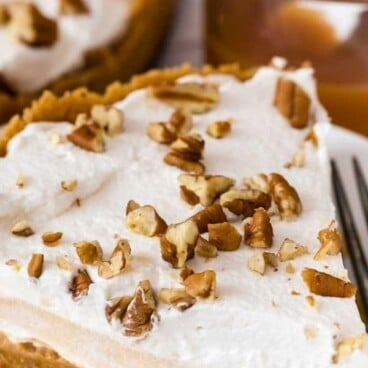 Slice of butterscotch pie on a white plate with recipe title on top of photo