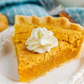 One slice of peanut butter chess pie with whipped cream on top
