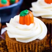 Close up of pumpkin cupcake with pumpkin candy on top