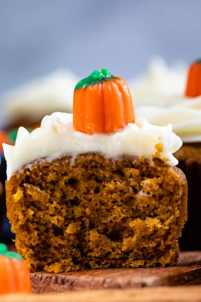 Close up of pumpkin cupcake cut in half to show middle