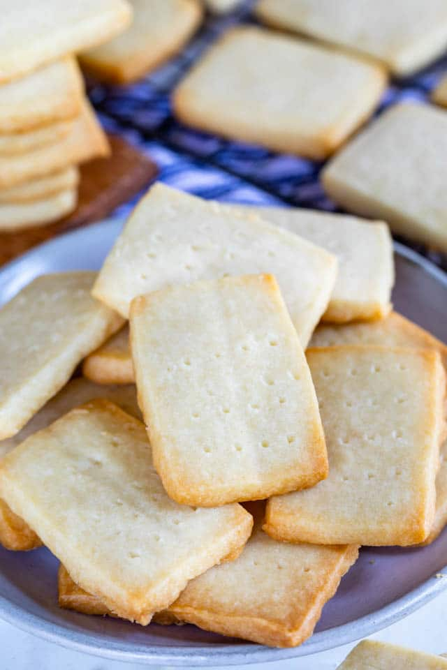 Overhead shot of shortbread cookies on a periwinkle colored plate