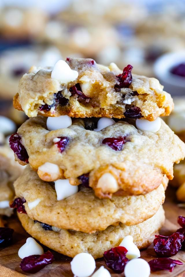 Stack of cranberry white chocolate cookies with top cookie split in half to show inside