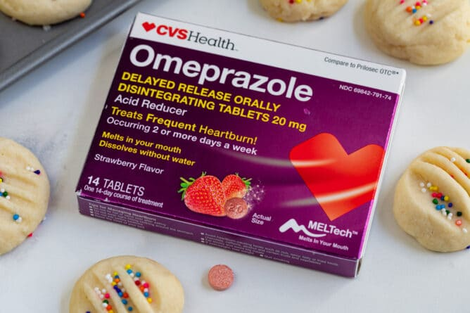 box of Omeprazole ODT with cookies around it