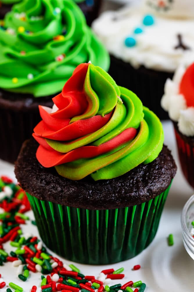 christmas cupcake in green liner with green and red swirled frosting