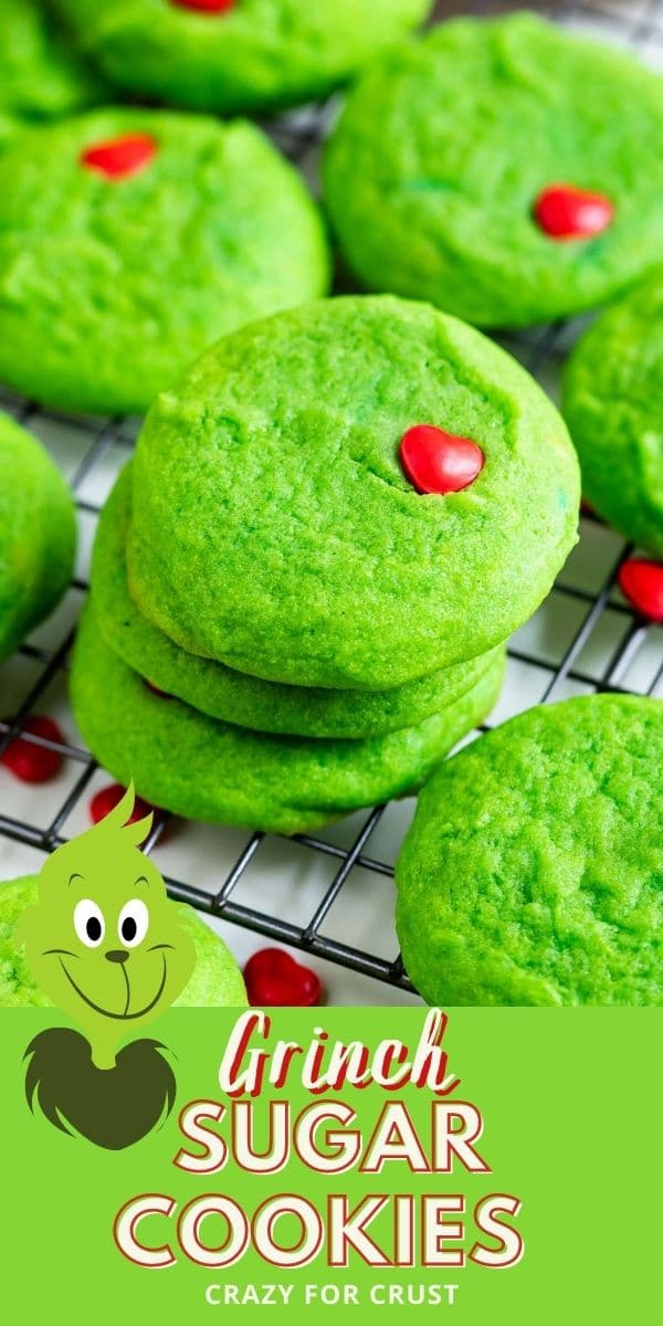 Grinch cookies stacked on a metal wire with recipe title and grinch graphic on bottom of photo