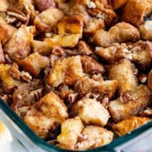 Monkey Bread in a glass baking dish with pecans on top and recipe title on bottom of image