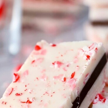 Close up of one peppermint bark piece with recipe title on top of image