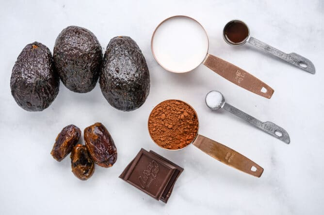 Overhead shot of all ingredients measured out for avocado chocolate mousse
