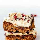 Two cranberry bliss bars stacked on eachother
