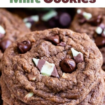 Overhead view of double chocolate mint cookies stacked high with recipe title and holiday pattern on top of photo
