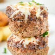 Close up shot of two mini meatloaves stacked on eachother