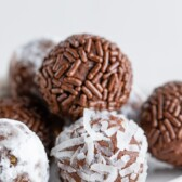 Close up shot of chocolate avocado truffles with sprinkles and coconuts on the outside