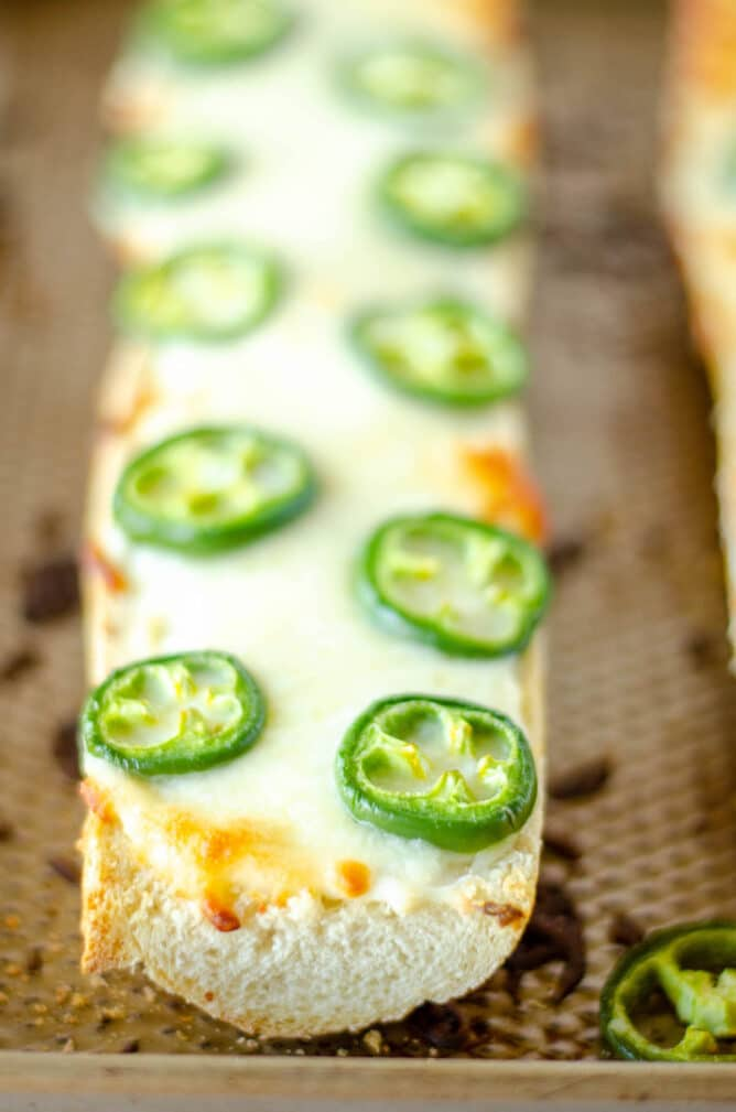 Close up shot of jalapeno cheese bread on sheet pan after baking