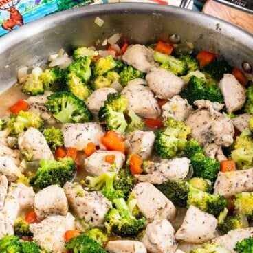 garlic butter chicken in skillet with vegetables and words on photo