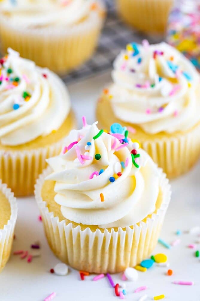 Perfect vanilla cupcakes with vanilla buttercream and rainbow sprinkles on top