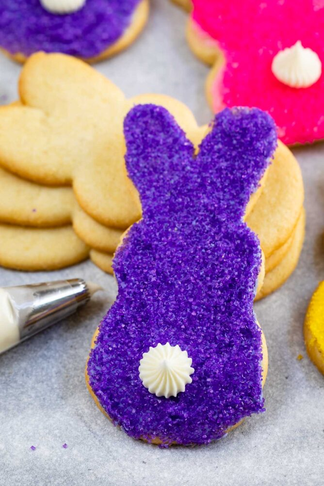 Close up shot of purple bunny butt cookie with white icing tail