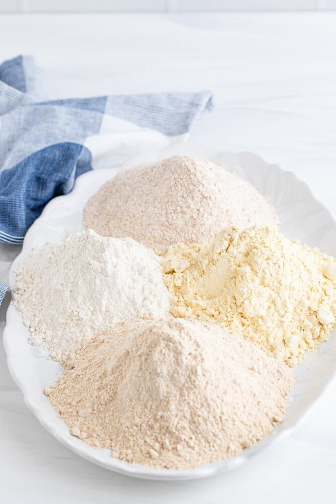 Four types of baking flours on a serving dish