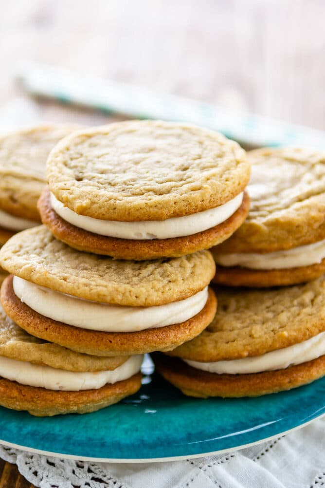 Stack of homemade golden oreos on a blue plate