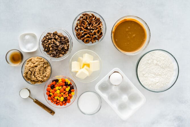 Overhead shot of all the ingredients for toffee pretzel peanut butter cookies
