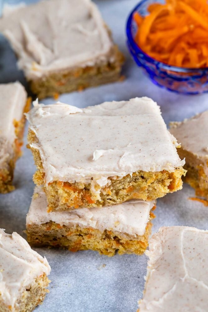 Overhead shot of carrot cake blondie squares on parchment paper