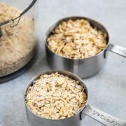 Stainless steel cups of old fashioned and quick oats