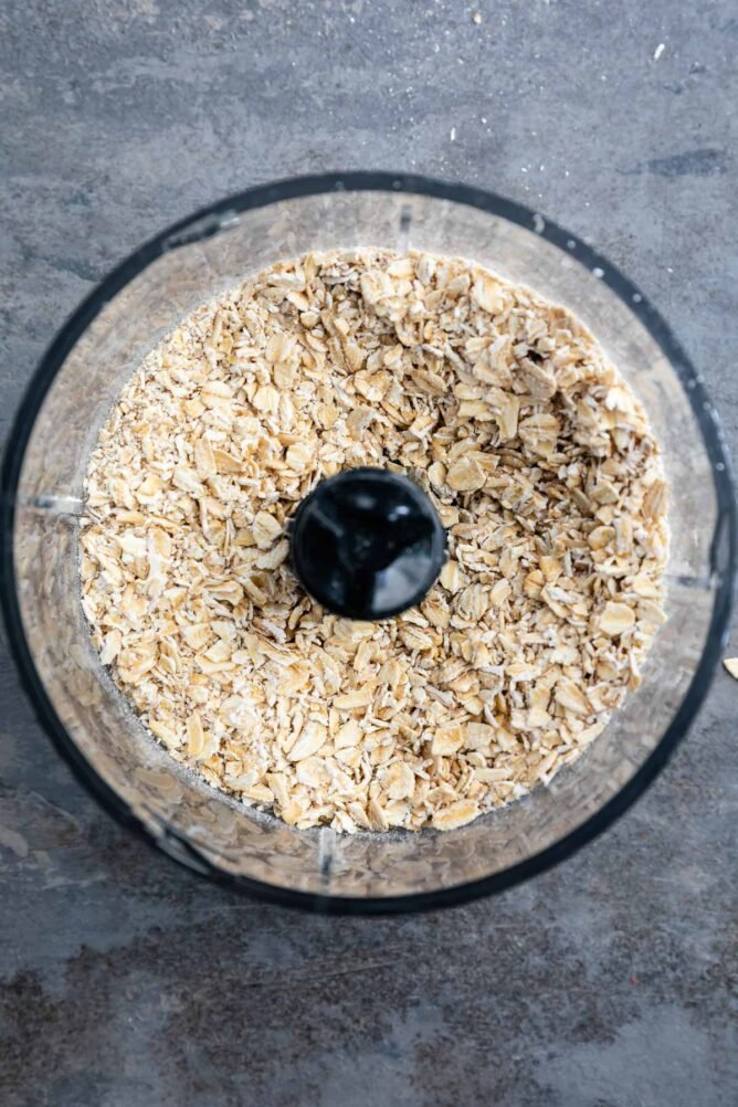 Overhead shot of old fashioned oats in a food processor after being processed
