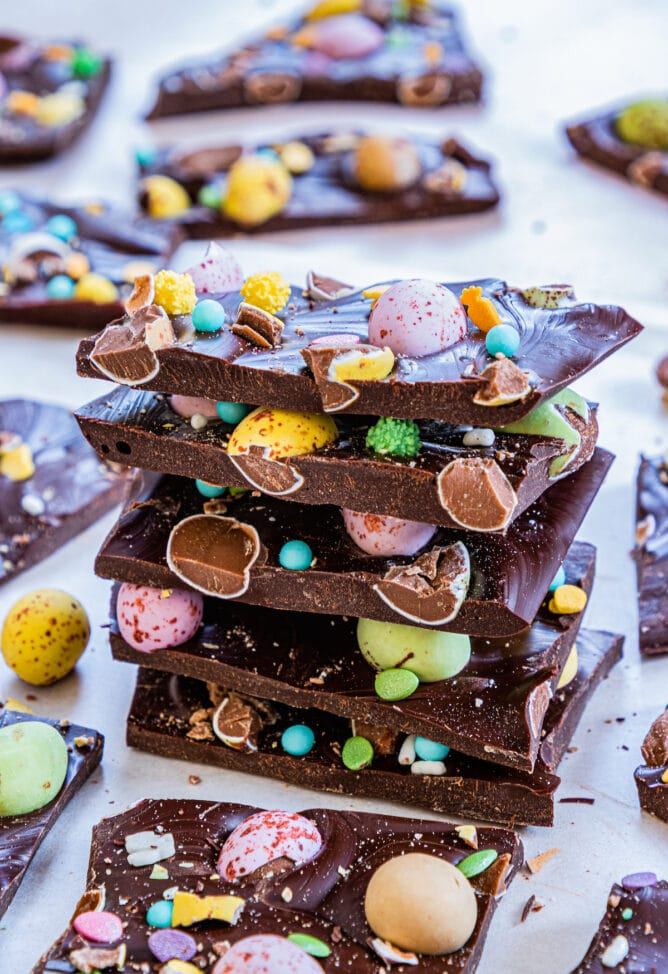 Easter candy bark pieces stacked on top of eachother