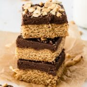 Three peanut butter cookie fudge bars stacked on eachother