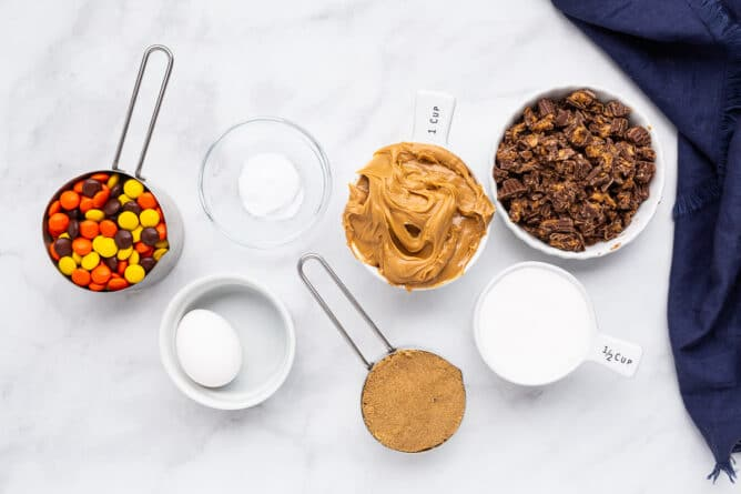 Overhead shot of all the ingredients measured out to make Reese's overload peanut butter cookies