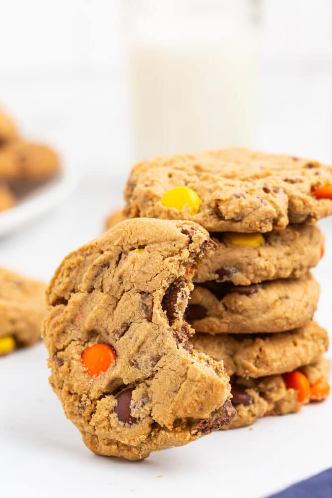 Stack of Reese's overload peanut butter cookies with one cookie missing a bite from it