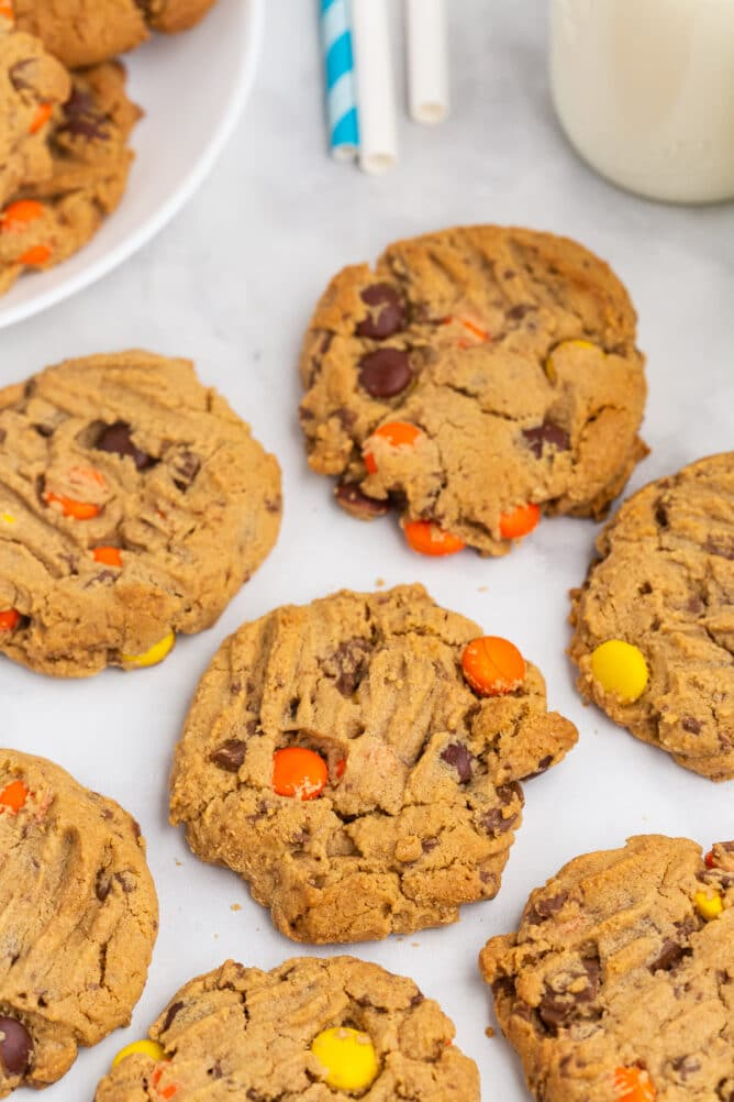 Reese's overload peanut butter cookies on parchment paper