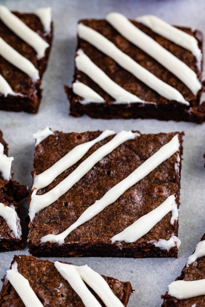Close up shot of carrot cake brownies cut into squares with a cream cheese glaze