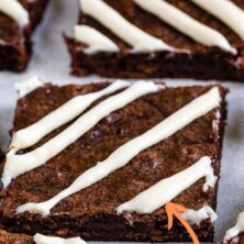 Close up shot of carrot cake brownies cut into squares with a cream cheese glaze with recipe title on top of image