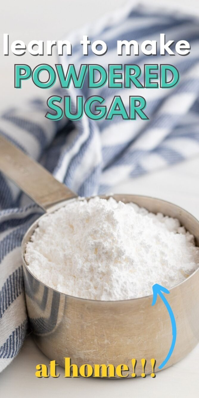 Stainless steel measuring cup full of powdered sugar with post title on top of image
