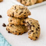 Stack of banana chocolate chip cookies with one tilted on side of stack