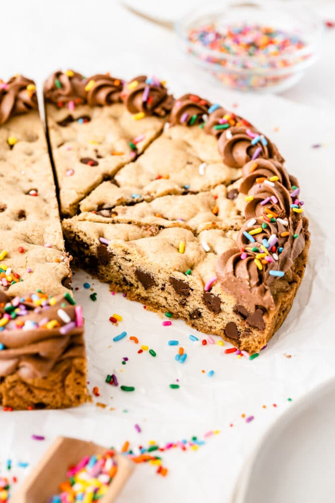 Cookie cake cut into slices with one slice missing