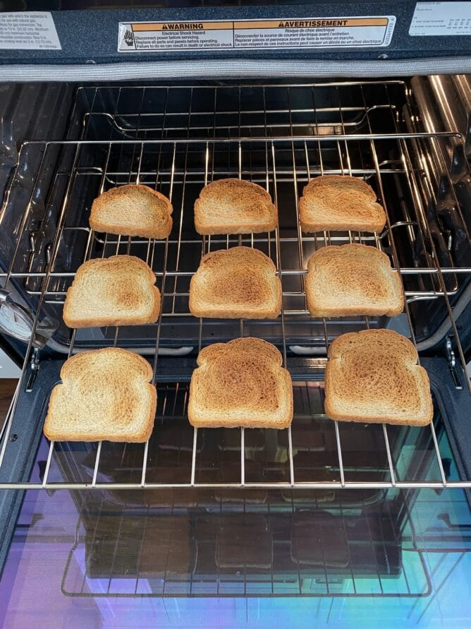9 slices of toasted bread on oven rack