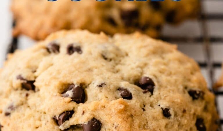 Close up side shot of banana chocolate chip cookies on a metal cooling rack with recipe title on top of image