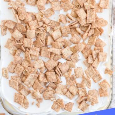 Overhead shot of cinnamon toast crunch poke cake with recipe title on bottom of photo