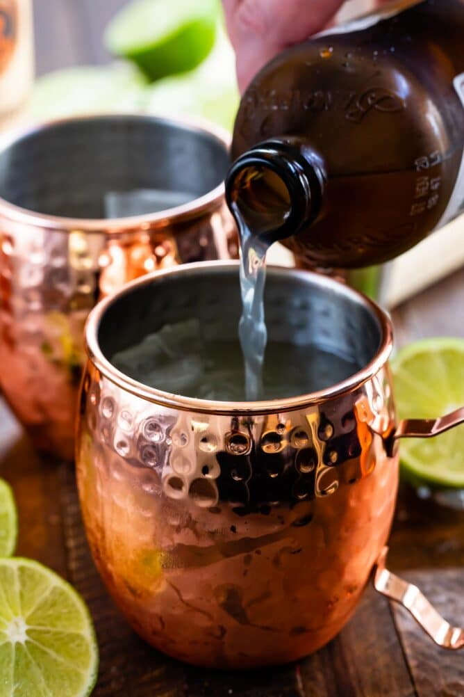 Ginger beer being poured into moscow mule mug