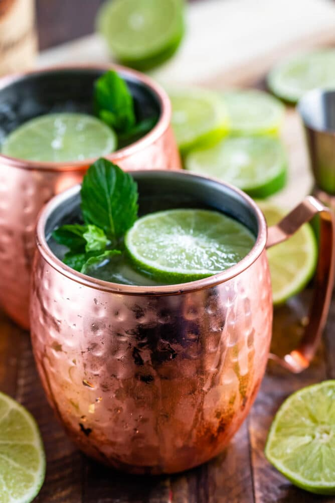 Two moscow mules topped with mint and lime
