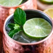 Close up overhead shot of moscow mule topped with mint leaves and a lime slice