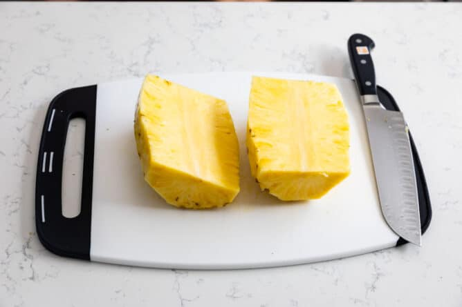 pineapple wedges on white cutting board