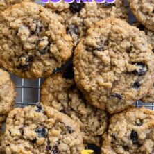 Overhead shot of oatmeal raisin cookies on wire cooling rack with recipe title on top of image
