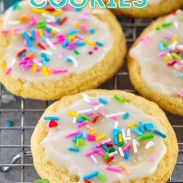 Five sugar cookies with icing and sprinkles on a wire cooling rack with recipe title on top of image