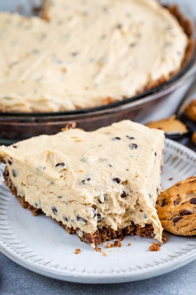 One slice of chocolate chip peanut butter pie with one bite missing