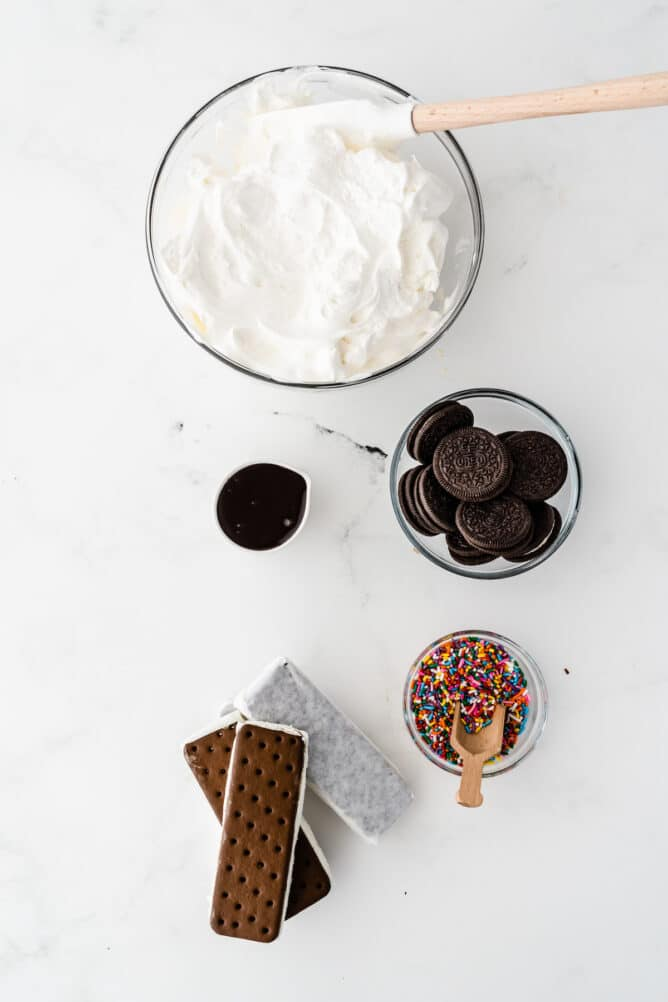 Overhead shot showing five ingredients needed to make ice cream sandwich cake