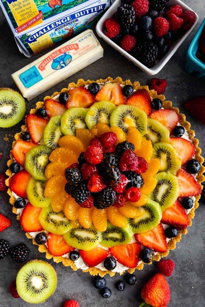 Overhead shot of no bake fruit tart with ingredients around it