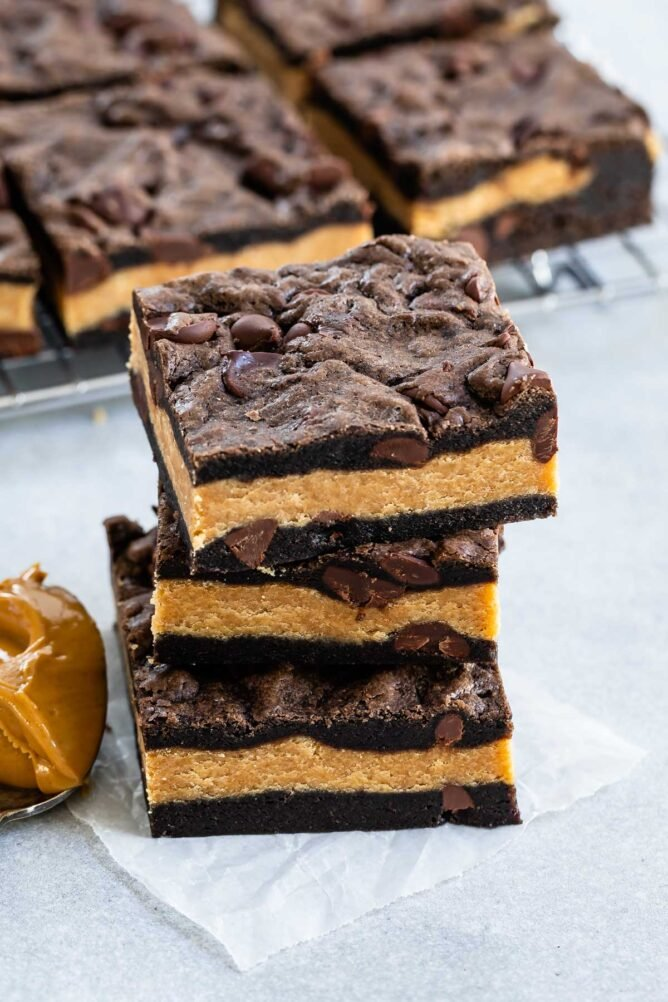 Stack of peanut butter stuffed chocolate cookie bars