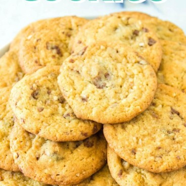 Plate full of almond joy pudding cookies with recipe title on top of image